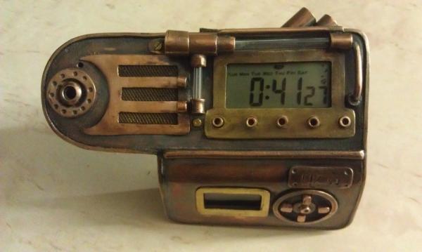 Часы Clk03