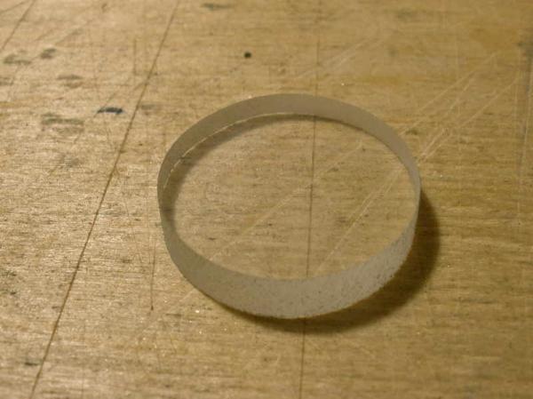 Приспособление для точной обработки круглых стекол.