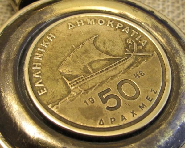 139. Монетка 50 драхм.