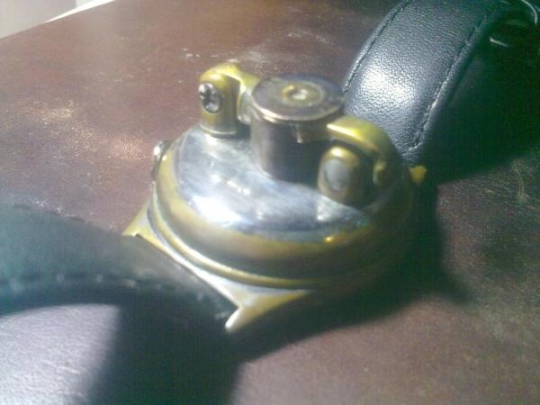Наручная зажигалка. (Фото 8)