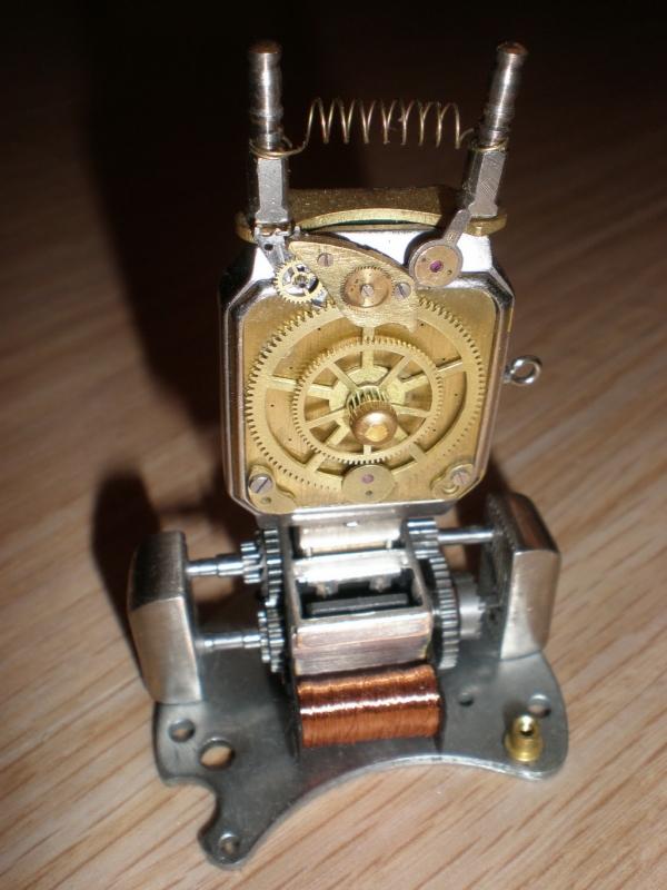 Электромеханический информационный передатчик.