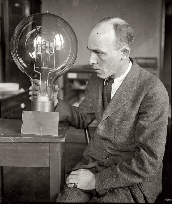 "March 12, 1925. ""C.W. Mitman of Smithsonian Institution with giant and midget bulbs."" National Photo Company Collection glass negative."