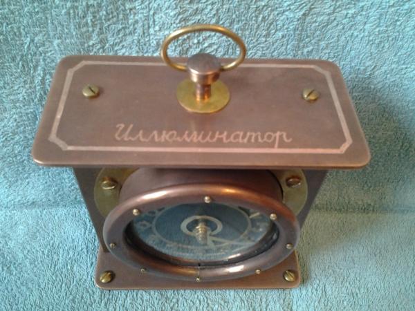 Каминные часы Иллюминатор.